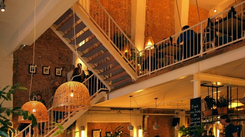 brick wall interior, cafe, renovated historic building, loft living