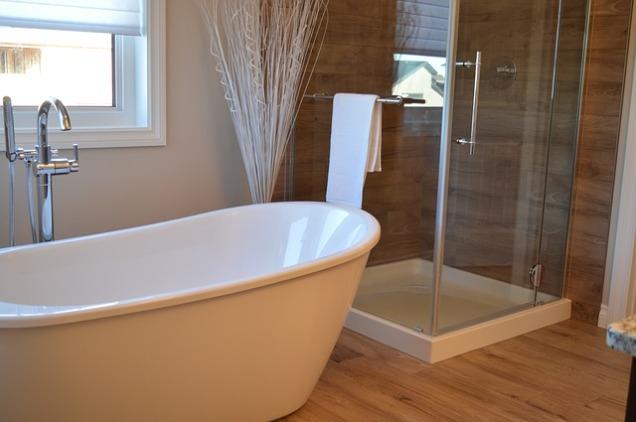 white modern bathroom, soaking tub, renovated bathroom, wood in bathroom, bathroom reno