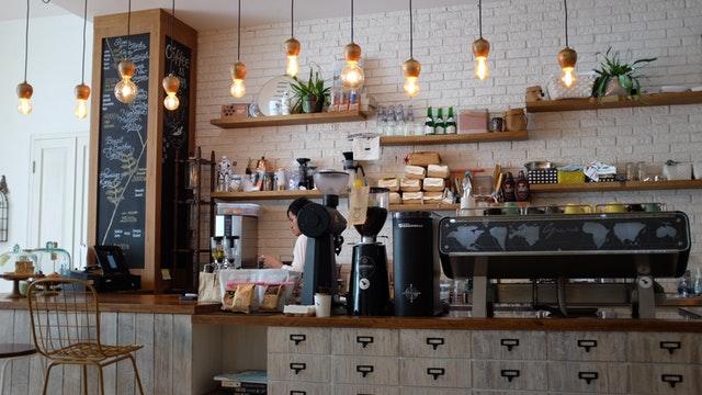 cafe design, white wash brick wall, light fixtures, espresso bar design, interior designers in MA