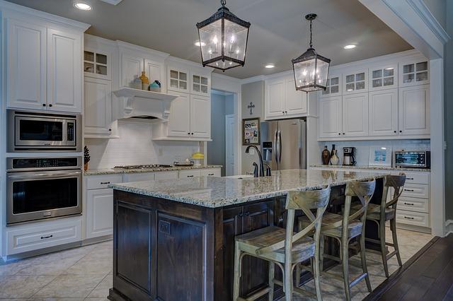white traditional kitchen, lantern island light fixtures, brown cabinet islands, interior designers in MA, kitchen remodel ideas, kitchen designers in MA, kitchen and bath blogs