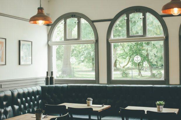 restored cafe, copper lights, black leather booths, vintage cafe design, Paris cafe, french bistro