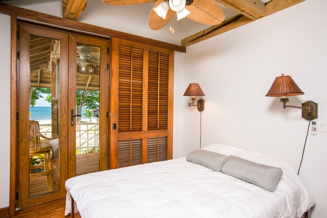 tropical bedroom, teak wood, simple bedroom interiors, rustic resorts, hotel bedroom ideas, interior designers in MA
